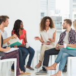 people sitting in a group talking